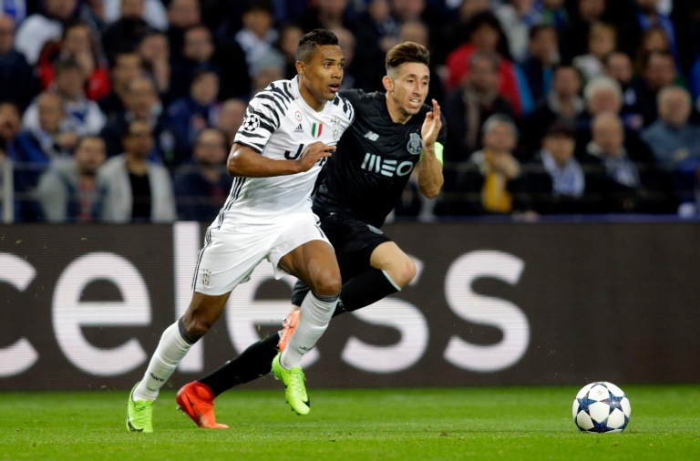 FC Porto's Hector Herrera in action with Juventus' Alex Sandro