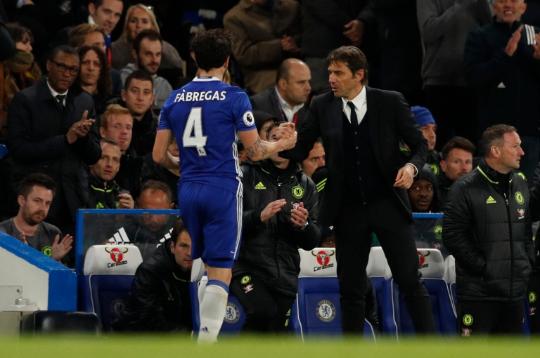 Chelsea's Cesc Fabregas is congratulated by manager Antonio Conte as he is substituted