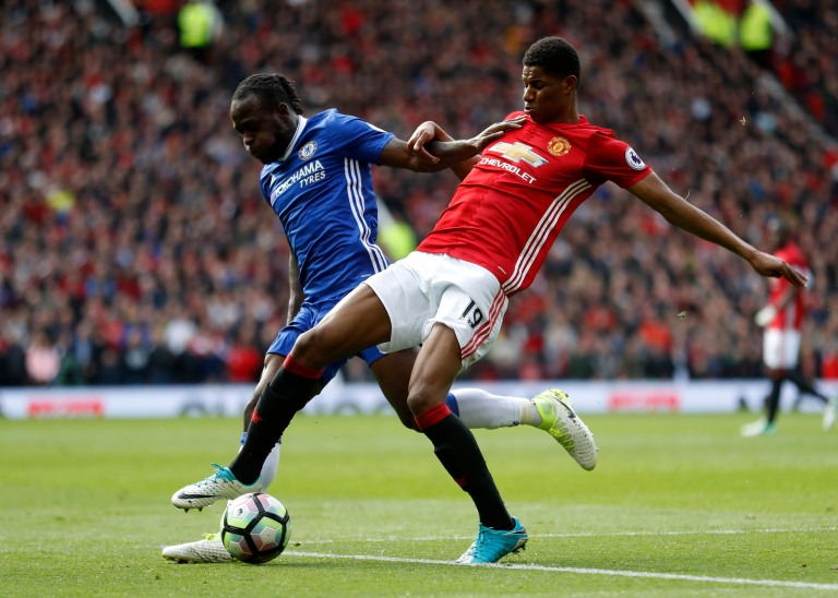 Manchester United's Marcus Rashford in action with Chelsea's Victor Moses