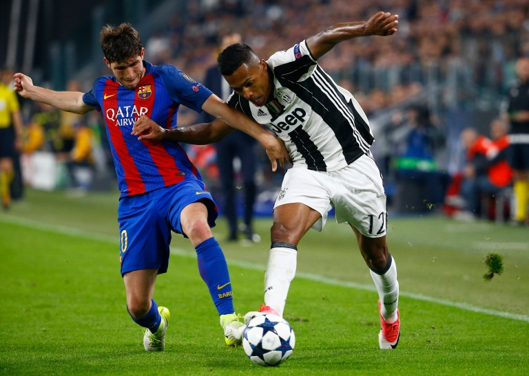 Juventus' Alex Sandro in action with Barcelona's Sergi Roberto